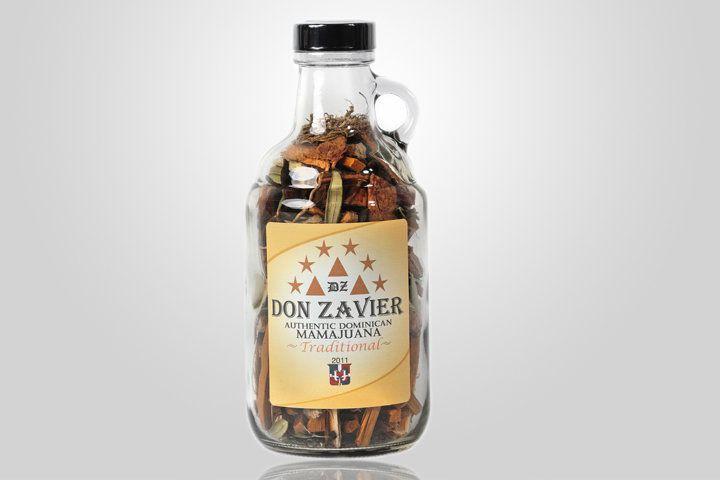 A glass jug of Don Zavier Mamajuana mix