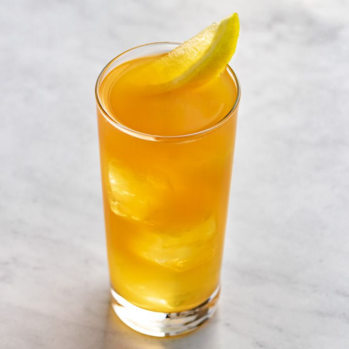 Backyard Iced Tea with lemon wedge garnish, served on white marble surface