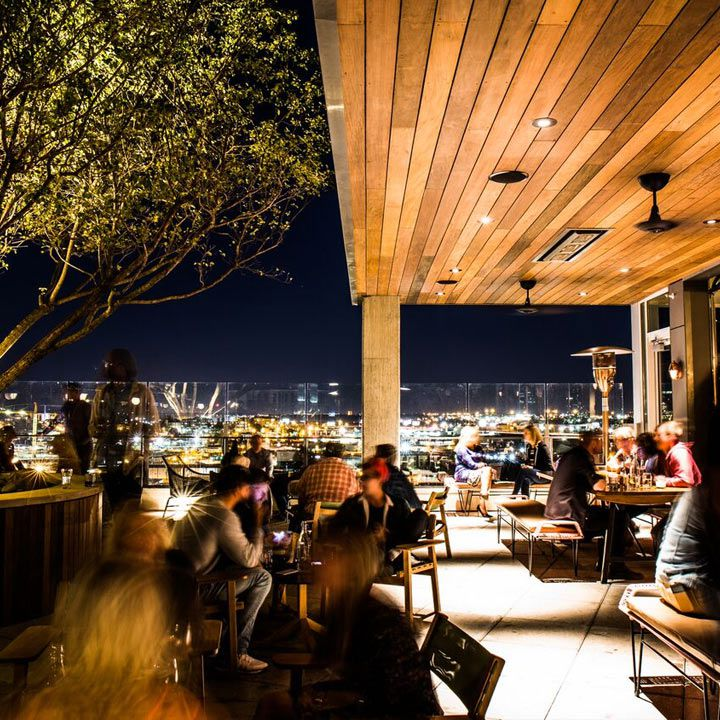 L.A. Jackson rooftop bar, with a blond wood overhang and beautiful night views of the cityscape