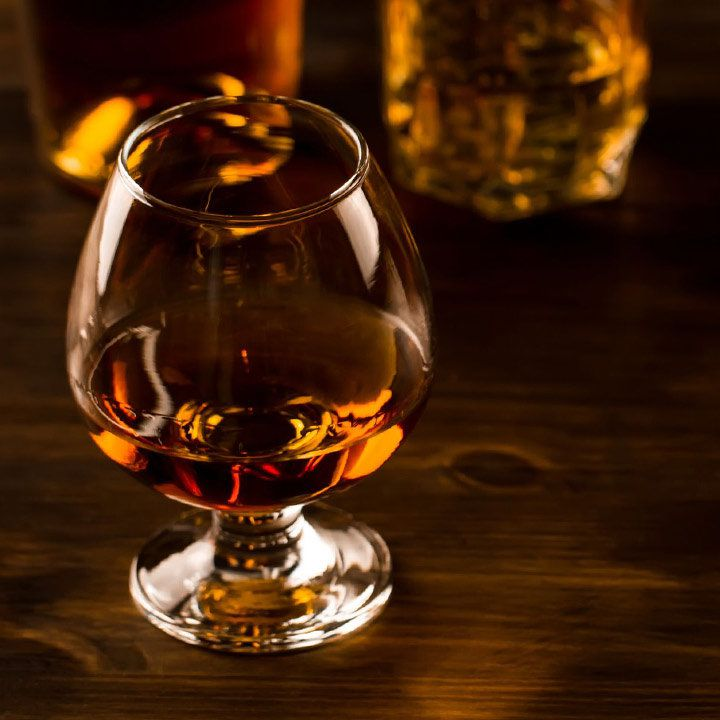 Armagnac in a small snifter with two bottles in the background