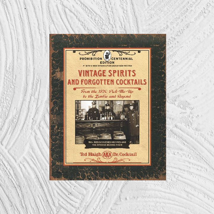 Vintage Spirits and Forgotten Cocktails cover with textured black border around a parchment-esque color block containing ornate title and other text with filigree interspersed