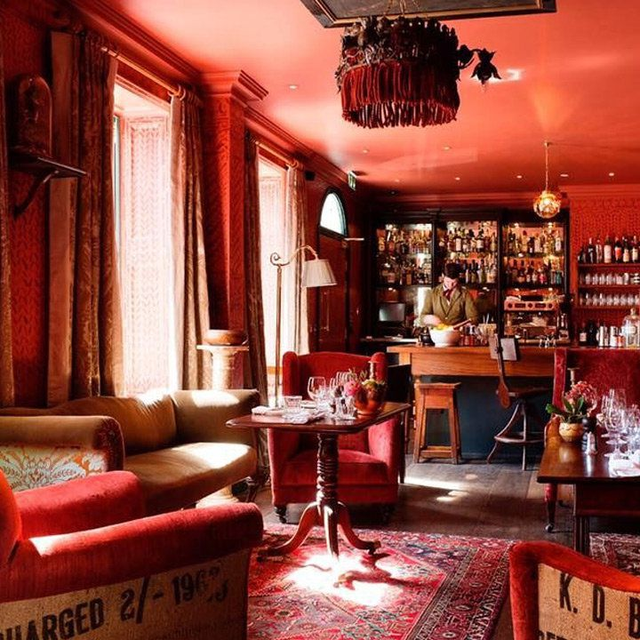 The Zetter Townhouse Clerkenwell interior with cozy brick-red decor