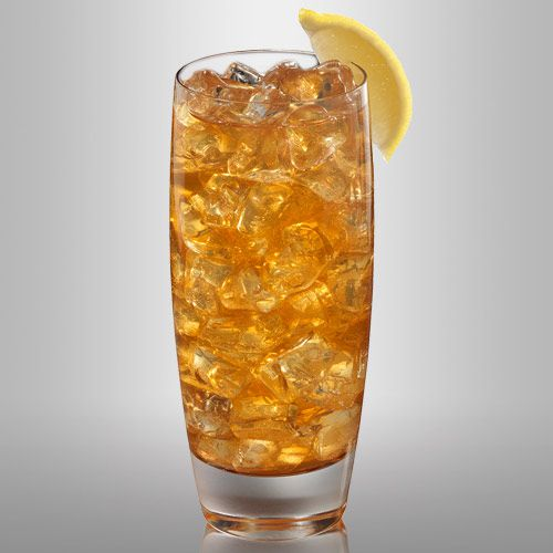 On a blank white background, a tall highball glass is packed with cracked ice and filled with a golden-brown drink. A single lemon slice garnishes the glass.