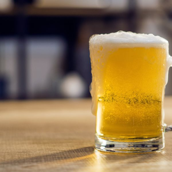 Mug of light beer with foam - pilsner