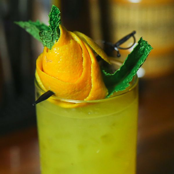 Orange peel and mint sprig rose garnish