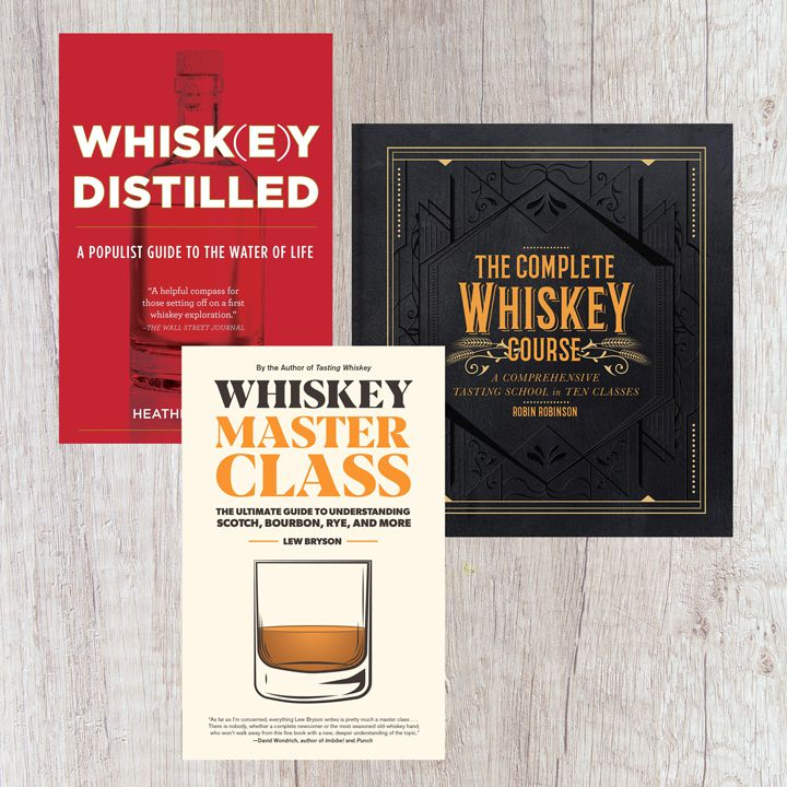 Whiskey books composite with three titles in various colors against a whitewashed wood background