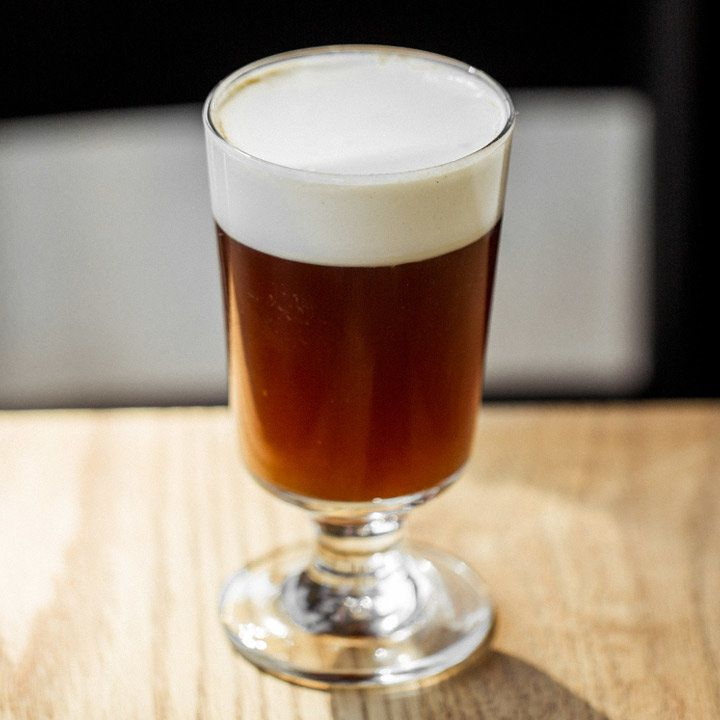 Rich Coffee cocktail with a white foamy head served in a short-stemmed glass