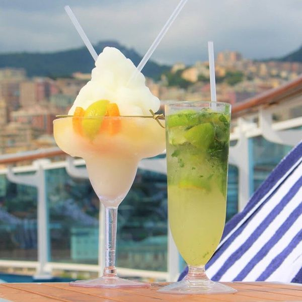 Cocktails on the deck of Princess Cruises. a mojito and a frozen citrus drink in a margarita glass