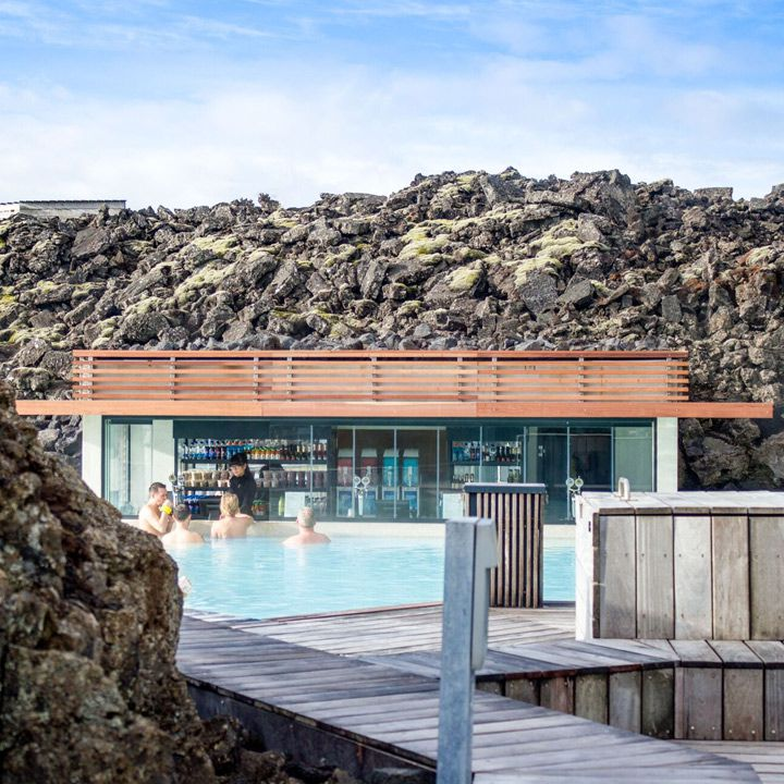 Blue Lagoon swim-up bar in Iceland. Volcanic rock peers over all sides of this modernist swim-up bar