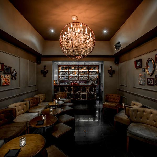Red Frog speakeasy interior, with a stunning chandelier surrounded by a metal globe