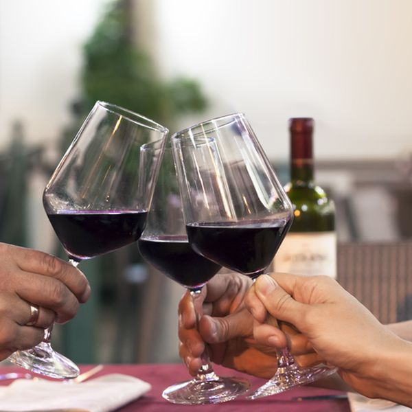 Group of friend clinking glasses of wine