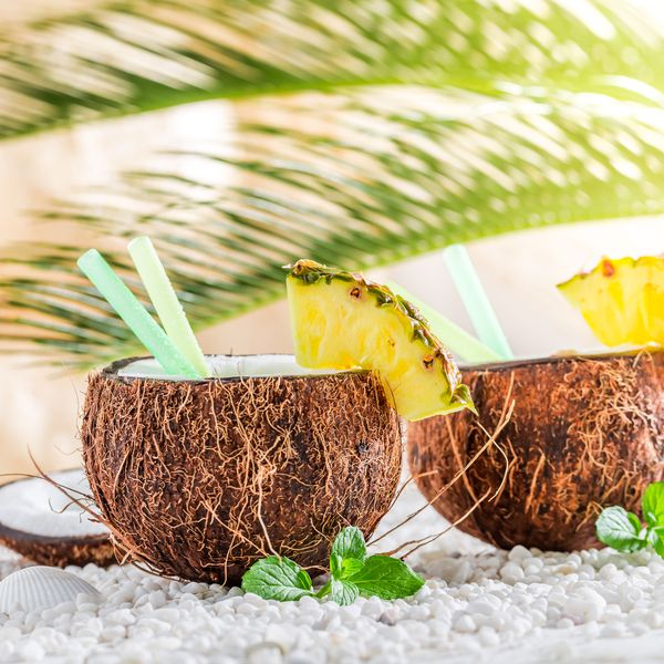 cocktail in two coconuts with palm