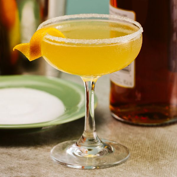 sidecar cocktail in a sugar-rimmed coupe with an orange twist