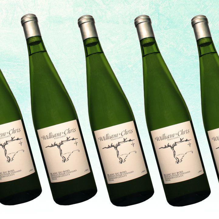William Chris Enoch's Stomp Vineyard Blanc du Bois bottles