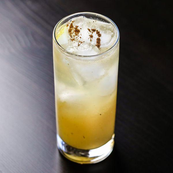 Pear & Elderflower Collins topped with freshly grated cinnamon
