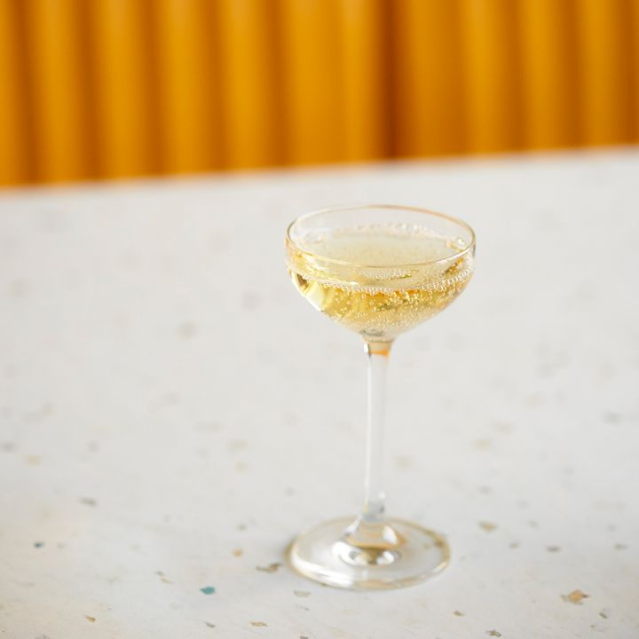 Cocktail made with Krug Champagne, water jelly and spiked herbs