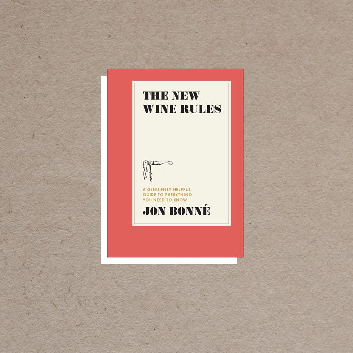 The New Wine Rules cover, dark coral border with offset ivory rectangle in center containing all-caps black and gold text and a small corkscrew illustration