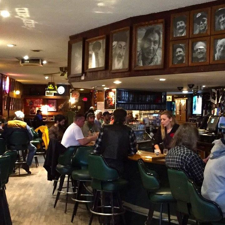 Charlie B's in Missoula. a bunch of portraits of important locals hang over the bar
