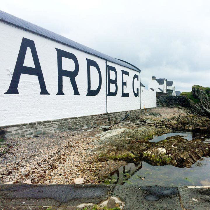 ardbeg distillery with the distillery's name in huge block letter on the side of a white building