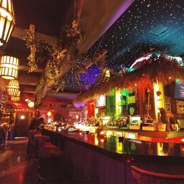 The Golden Tiki bar in Las Vegas. Hut fringe drapes over the back of the bar.
