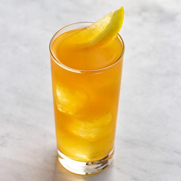 Backyard Iced Tea with lemon wedge garnish, served on white marble surface