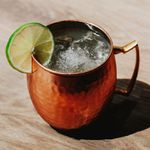 London Mule cocktail in a copper mug with a lime wheel