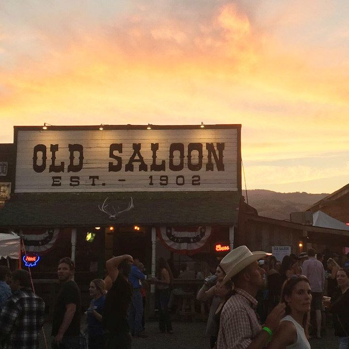 old saloon montana with a stunning big yellow sky behind the exterior