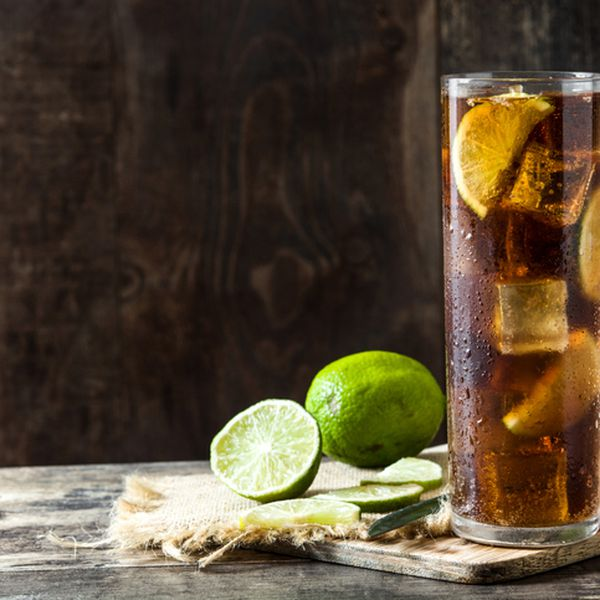 Cocktail with rum, lime and ice.