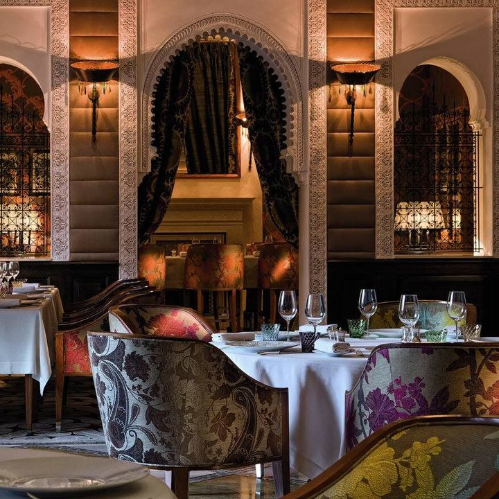 royal mansour hotel dining room, with floral-patterned charis and tall arches