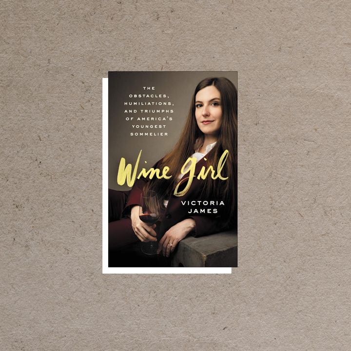 Wine Girl cover featuring portrait of author and a glass of wine against a dark gray background, overlaid with white and yellow text