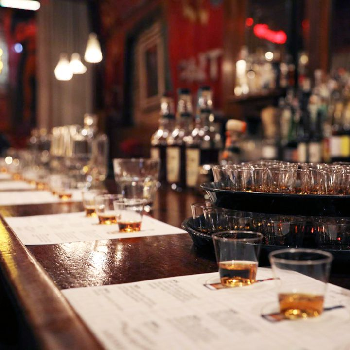 View of a tasting setup at a bar with glasses of whiskey.