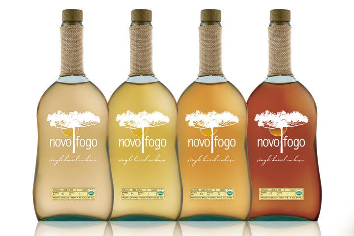 A lineup of the Novo Fogo cachaça bottles, arranged lightest to darkest from left to right