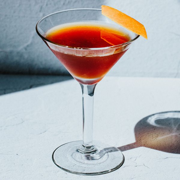 Blood and Sand in a cocktail glass with an orange peel garnish