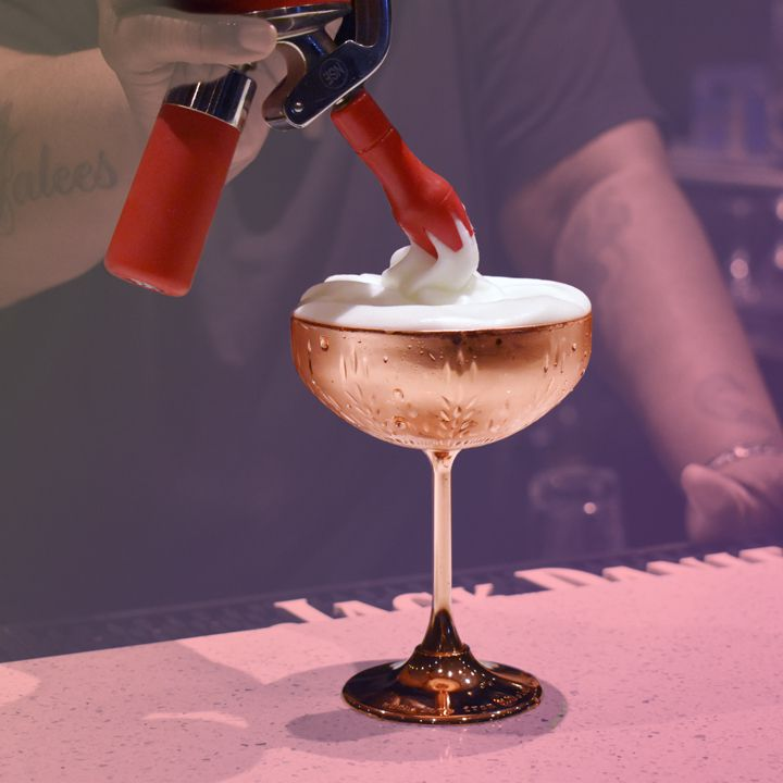 Using a whipped cream dispenser as a bartending tool