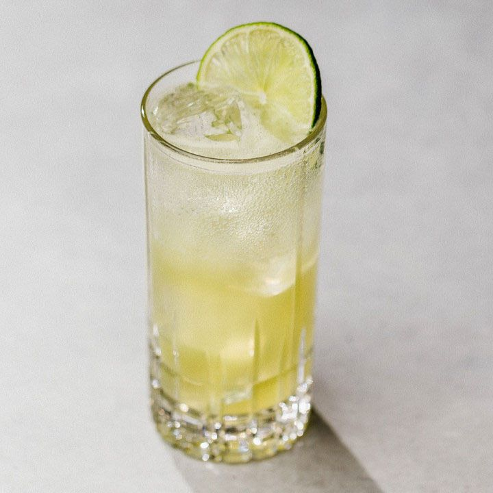 Mint-Basil Limeade with ice in a Collins glass, garnished with a lime wheel