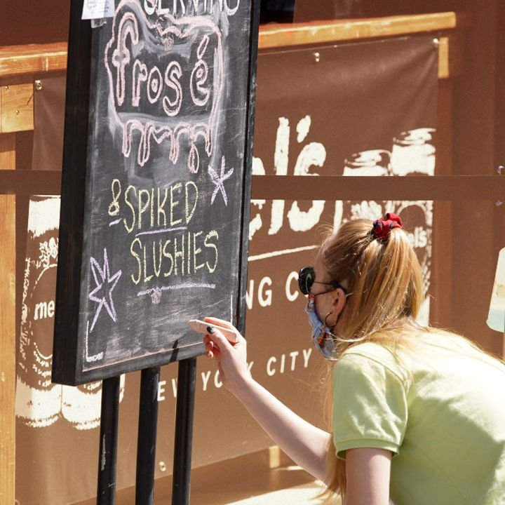 Sign advertising takeout cocktails