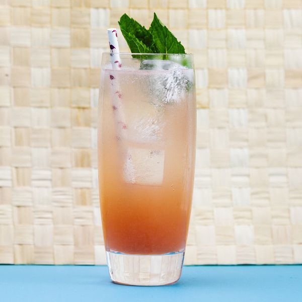 sea breeze cooler cocktail with straw and mint garnish