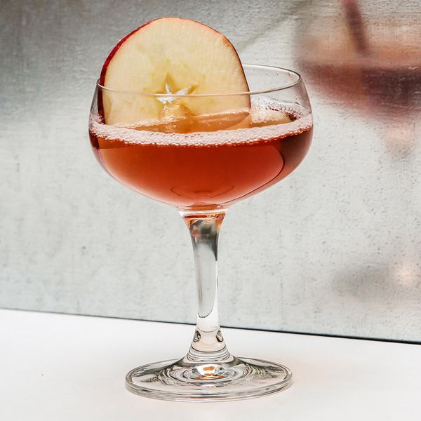 Washington Apple cocktail in a coupe glass garnished with an apple slice