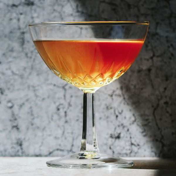 Between the Sheets cocktail in crystal coupe on marble surface