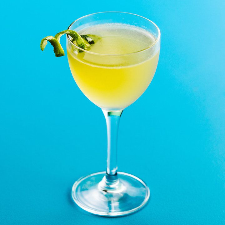The Bonpland cocktail with a lime twist, served on a bright blue backdrop