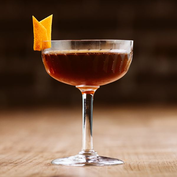 Revolver cocktail in a coupe glass with an orange peel garnish