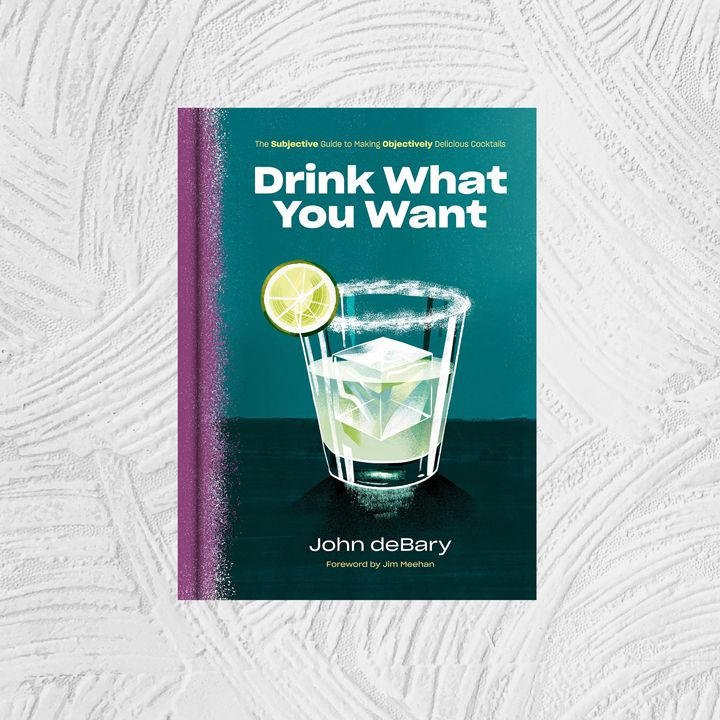Drink What You Want: The Subjective Guide to Making Objectively Delicious Cocktails cover with an aubergine painted binding and a large illustrated margarita in a rocks glass against a dark blue-green background