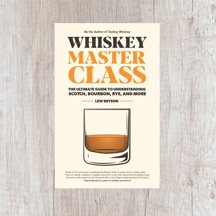 Whiskey Master Class cover, off white with black and orange text around an illustration of a rocks glass containing brown spirit. Cover is set against a light wood patterned frame