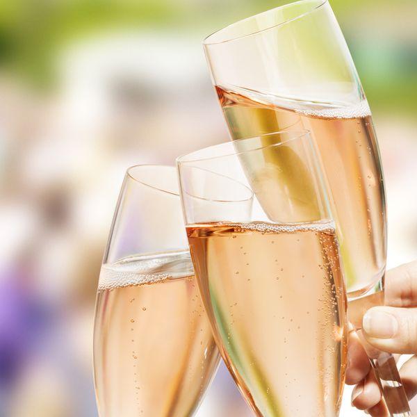 Three rose champagne glasses toasting