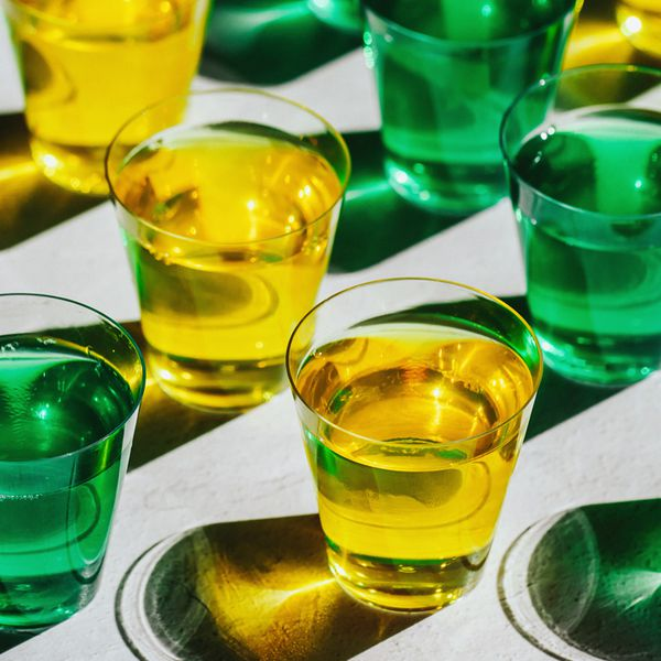 green and yellow Jello shots in plastic shot cups