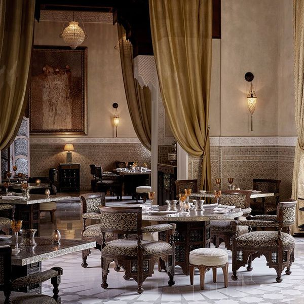 Royal Mansour's La Grande Table Marocaine restaurant dining room with enormous pulled-back taupe curtains and tiled walls
