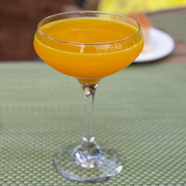 bright-orange always Sunny cocktail in a coupe glass