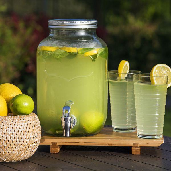 Lemonade prepared with lemon slices in a glass dispenser.
