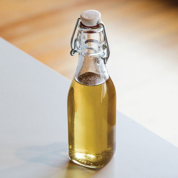 vanilla simple syrup in a swing-top bottle sitting on a white counter