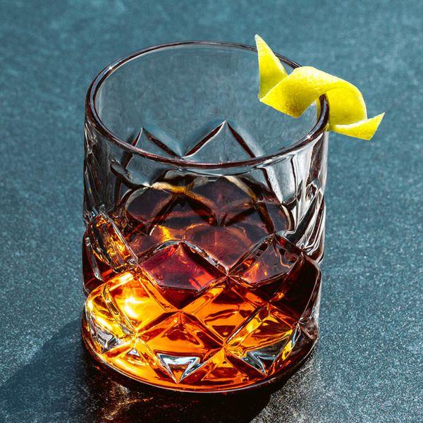 Original Sazerac cocktail in a crystal-cut glass with a lemon twist garnish
